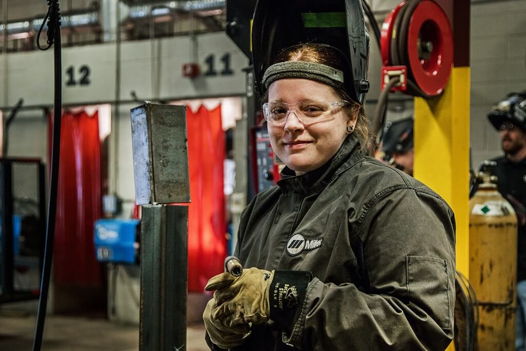 female welder in class