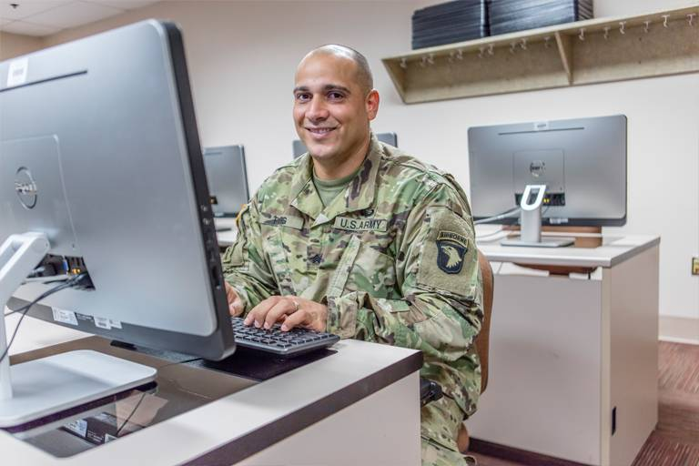 Uniformed Soldier at Computer
